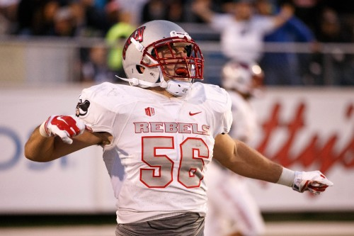 UNLV's Ryan McAleenan (56) celebrates his pick six