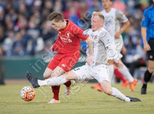 Sacramento Republic FC defender DEREK FORAN (2) tackles Liverpool FC U21 striker RYAN KENT (11)