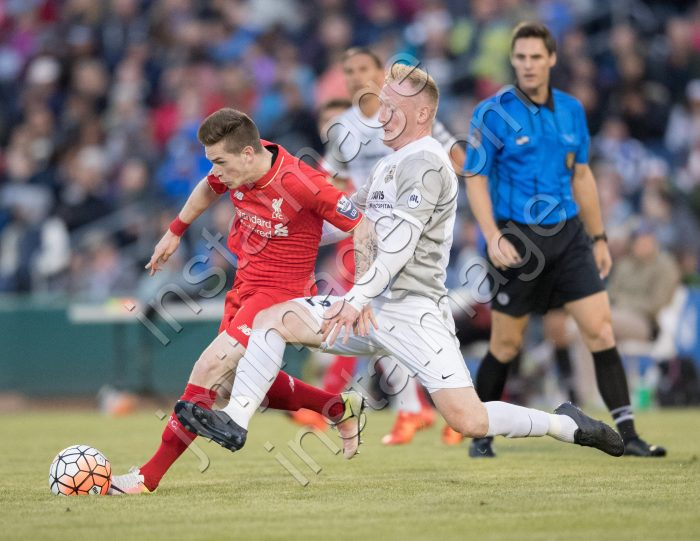 Sacramento Republic FC defender DEREK FORAN (2) tackles Liverpool FC U21 striker RYAN KENT (11)