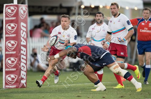 USA Rugby's JOE TAUFETE'E (16) tackles Russia Rugby's DMITRY GERASIMOV (12)